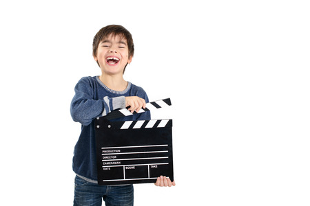 filmmaker: Laughing child holding clapperboard