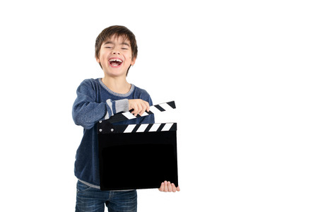 filmmaker: Boy holding black clapperboard Stock Photo