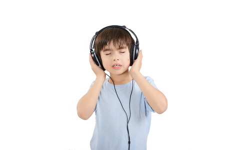 Cute boy is listening to music with eyes closed photo