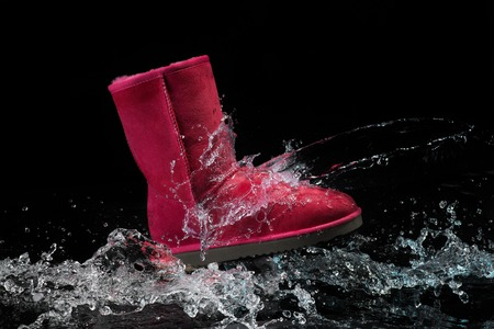 treads: shoes waterproof protected brown color with water droplets. Shoes wax protect shoes from water