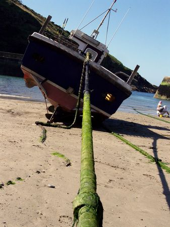 Crab Fishing Boat at Low Tide in Port Isaac Harbour, Cornwall, Uk