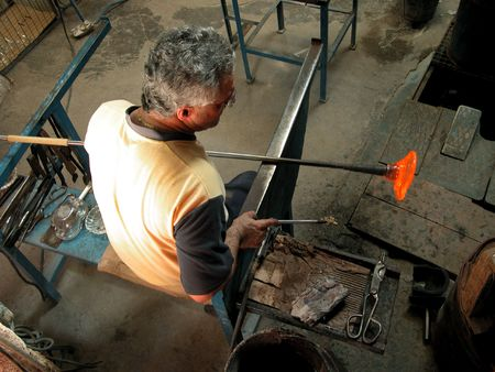 blown: Glass Making Artisan in His Workshop Stock Photo
