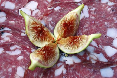 Platter of Salami Slices with Figs, popular sweet and savoury Italian appetizer  Stock Photo