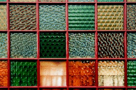 Brightly colored glass tiles of an Irish pub window