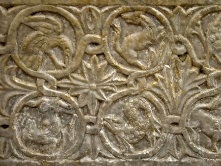 Stone carving with animal figures and  patterns in bas relief on ancient sarcophagus in Italy Stock Photo