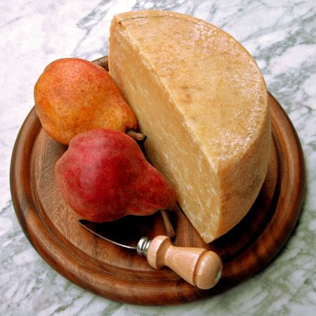 Still Life of Ripe Pears and Pecorino Cheese on a Wooden Tray