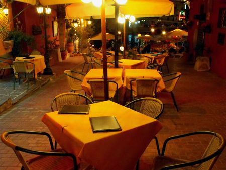 Night view of a restaurant terrace by the sea