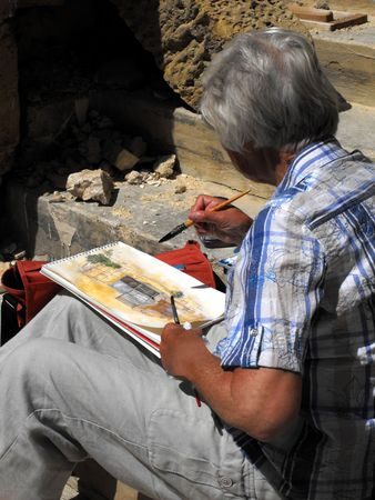 Valletta, Malta - May 2009 -  Senior lady tourist painting watercolor en plein air Editorial