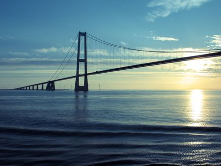 longest: Denmark: Great Belt Suspension Bridge at sunset