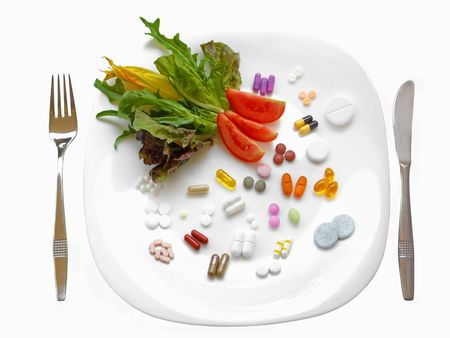 vitamins pills: Food supplements vs healthy diet Stock Photo