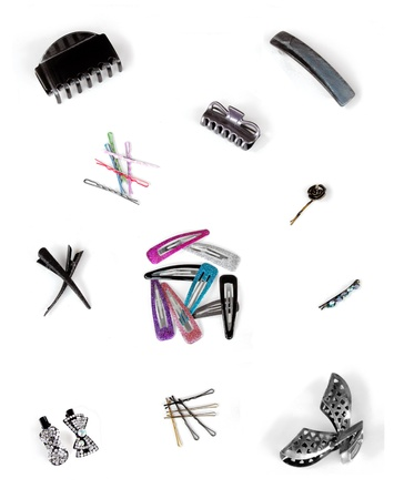 Colorful set of hair accessories: clips, tiepins, clamps, pins, bobbypins in different materials and styles. In clusters by type, isolated on white