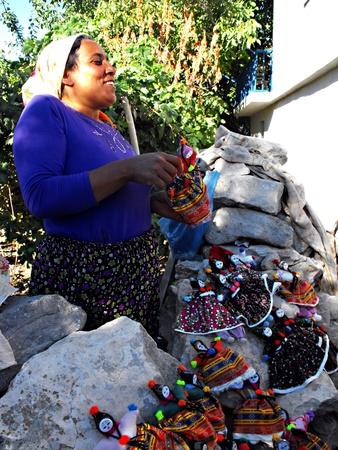 Street Vendor of Handmade Rag Dolls in Cappadocia village, Turkey, September 2011