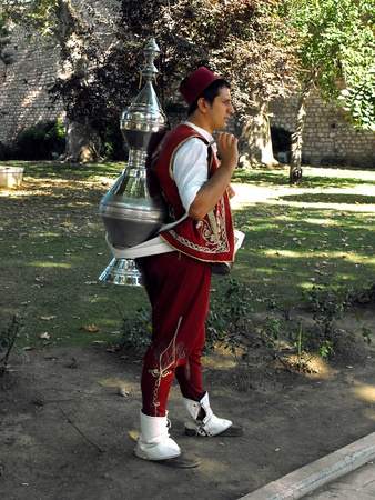 Tea Vendor in traditional costume in the Gardens of the Topkapi Palace, Istanbul, Turkey, September 2011