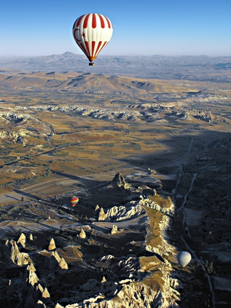 Hot Air Balloons at Sunrise of the Goreme Valley in Cappadocia, Turkey photo