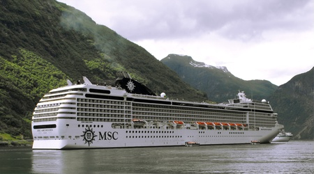 MSC Orchestra cruise ship at anchor in Geiranger Fjord, Norway, July 2010