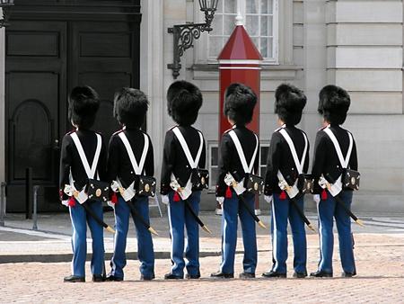 sightseers:  Changing of the Guard at Amalienborg Castle, Copenhagen, Denmark Stock Photo