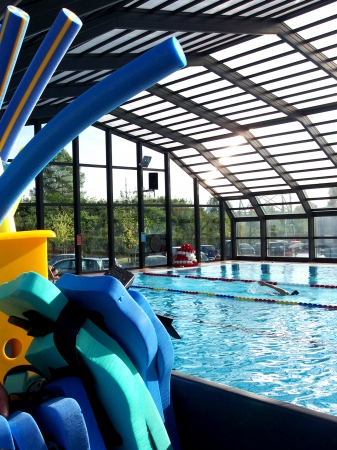 Glass Roofed Indoor Swimming Pool at Modern Sports Center