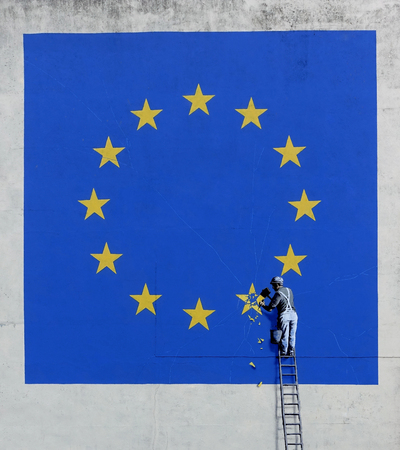 Banksy Brexit mural in Dover, England. Banksy's graffiti shows Britain's star chiselled off the EU flag. Artwork created May 2017, photo taken August 2017