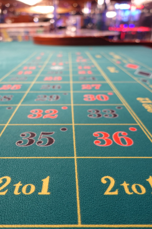 Casino roulette betting table green felt carpet Stock Photo
