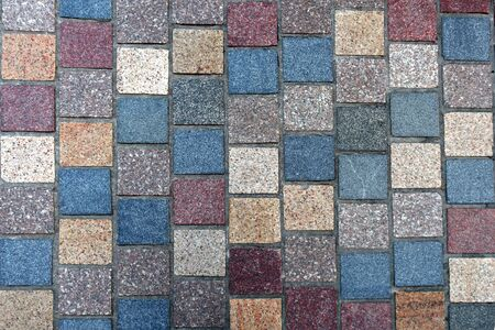 Colorful pattern of granite paving stones Imagens