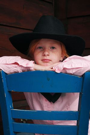 little cowgirl sitting on a chair Stock Photo - 1342215