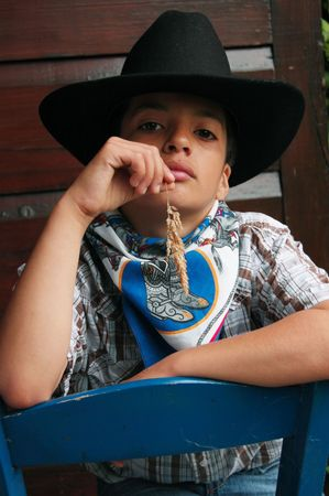little cowboy with grass in the mouth Stock Photo - 1342216