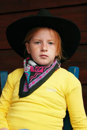 cowgirl sitting on a chair Stock Photo - 1342214