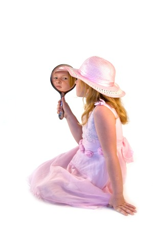 herself: young girl looking at herself in the mirror Stock Photo