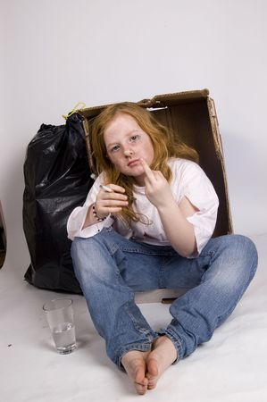 itinerant: homeless girl showing the middle finger