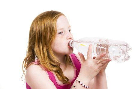 Portrait of a little young girl drinking water photo