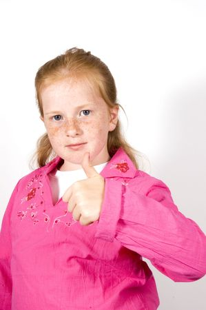 cute little girl with thumb up  photo