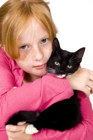 close up of girl and kitten photo