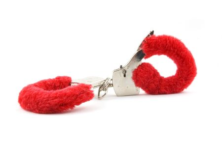 closed red handcuffs isolated on white background