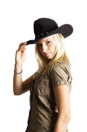 rodeo cowgirl: young rodeo cowgirl  holding cowboy hat Stock Photo