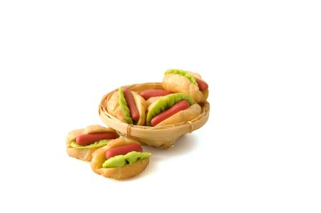 couple of hotdogs in a backet isolated on white
