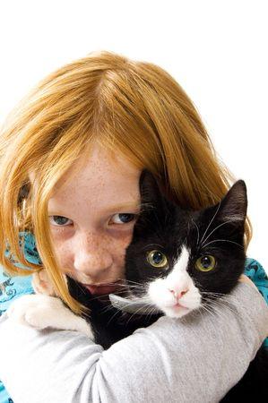 red head girl: red head girl holding a black white kitten