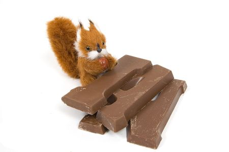 plushy: cute plushy squirrel with a chocolate letter for dutch holiday called sinterklaas on white Stock Photo
