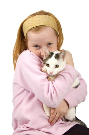 red head girl: red head girl holding a white cat on white Stock Photo