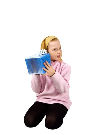 red head girl: red head girl is listening to a package on white