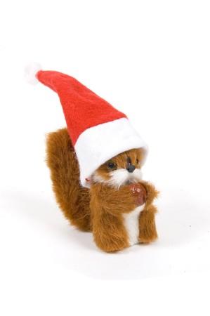 plushy: cute plushy squirrel wearing a christmas hat on white Stock Photo
