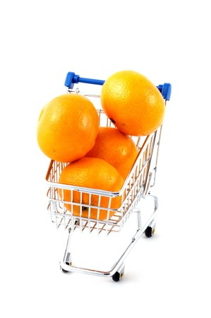 shopping cart filled with mandarines  isolated on white