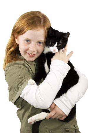 red head girl holding a black white kitten  Stock Photo