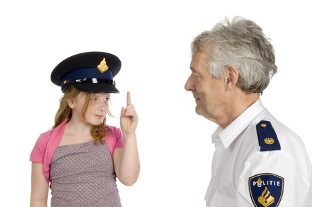 girl is warning a dutch police officer isolated on white
