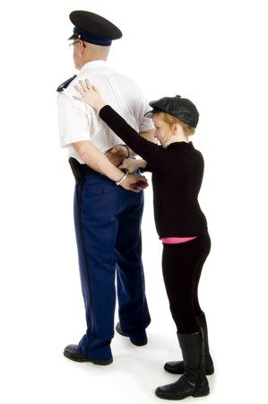 little girl is handcuffing a police officer on white photo