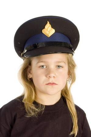 dutch girl: Little girl is wearing a police hat isolated on white Stock Photo
