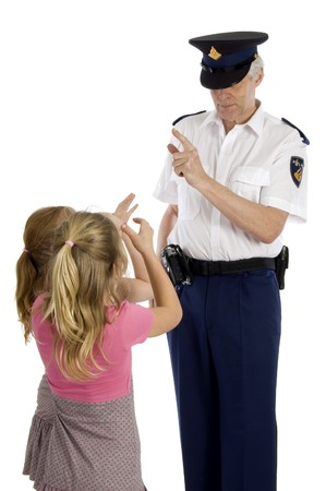 stern: Fully dressed dutch police officer is warning two little girls who are making long nose