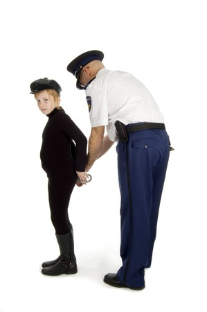 juvenile is been arrested by a dutch police officer on white Stock Photo - 4492637