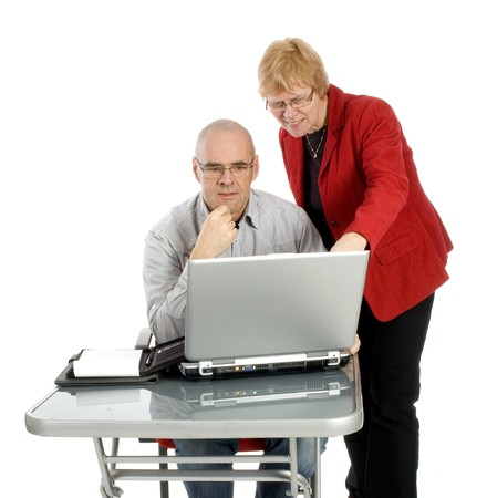 Boss is explaining work with a male secretary on white Stock Photo - 4523415