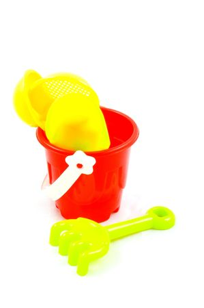 Red bucket and toys, isolated on white background  photo