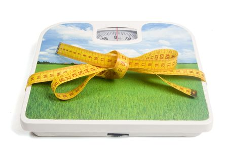 weight scale with a measure tape as a ribbon isolated on white